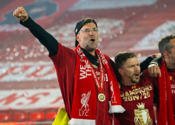 "LIVERPOOL, ENGLAND - Wednesday, July 22, 2020: Liverpool's manager Jürgen Klopp sings ""You'll Never Walk Alone"" with his staff and players after receiving being crowned Premier League champions after the FA Premier League match between Liverpool FC and Chelsea FC at Anfield. The game was played behind closed doors due to the UK government's social distancing laws during the Coronavirus COVID-19 Pandemic. Liverpool won 5-3. (Pic by David Rawcliffe/Propaganda)"