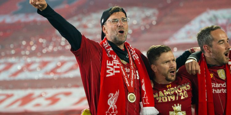 """LIVERPOOL, ENGLAND - Wednesday, July 22, 2020: Liverpool's manager Jürgen Klopp sings """"You'll Never Walk Alone"""" with his staff and players after receiving being crowned Premier League champions after the FA Premier League match between Liverpool FC and Chelsea FC at Anfield. The game was played behind closed doors due to the UK government's social distancing laws during the Coronavirus COVID-19 Pandemic. Liverpool won 5-3. (Pic by David Rawcliffe/Propaganda)"""