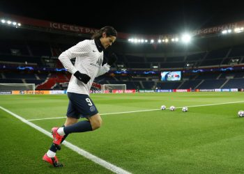 PARIS, FRANCE - MARCH 11: (FREE FOR EDITORIAL USE) In this handout image provided by UEFA, Edinson Cavani of Paris Saint-Germain runs out to warm up prior to the UEFA Champions League round of 16 second leg match between Paris Saint-Germain and Borussia Dortmund at Parc des Princes on March 11, 2020 in Paris, France. The match is played behind closed doors as a precaution against the spread of COVID-19 (Coronavirus).  (Photo by UEFA - Handout/UEFA via Getty Images)