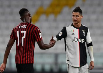 Juventus' Portuguese forward Cristiano Ronaldo taps hand with AC Milan's Portuguese forward Rafael Leao at the end of the Italian Cup (Coppa Italia) semi-final second leg football match Juventus vs AC Milan on June 12, 2020 at the Allianz stadium in Turin, the first to be played in Italy since March 9 and the lockdown aimed at curbing the spread of the COVID-19 infection, caused by the novel coronavirus. (Photo by Miguel MEDINA / AFP) (Photo by MIGUEL MEDINA/AFP via Getty Images)