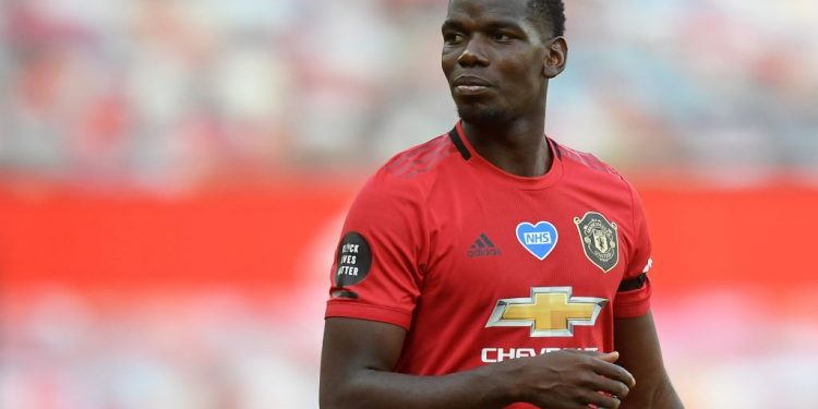 Manchester United's French midfielder Paul Pogba reats during the English Premier League football match between Manchester United and Sheffield United at Old Trafford in Manchester, north west England, on June 24, 2020. (Photo by Michael Regan / POOL / AFP) / RESTRICTED TO EDITORIAL USE. No use with unauthorized audio, video, data, fixture lists, club/league logos or 'live' services. Online in-match use limited to 120 images. An additional 40 images may be used in extra time. No video emulation. Social media in-match use limited to 120 images. An additional 40 images may be used in extra time. No use in betting publications, games or single club/league/player publications. /  (Photo by MICHAEL REGAN/POOL/AFP via Getty Images)