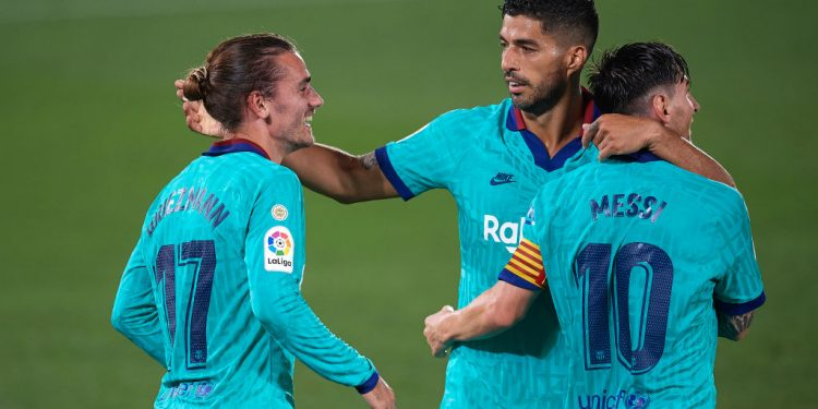 Antoine Griezmann of Barcelona celebrates with Lionel Messi and Luis Suarez after scoring his sides second goal during the Liga match between Villarreal CF and FC Barcelona at Estadio de la Ceramica on July 5, 2020 in Villareal, Spain. (Photo by Jose Breton/Pics Action/NurPhoto via Getty Images)