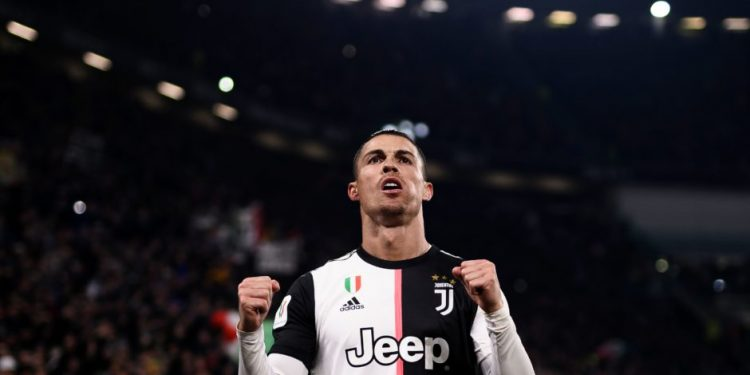 Juventus' Portuguese forward Cristiano Ronaldo celebrates after opening the scoring during the Italian Cup (Coppa Italia) round of 8 football match Juventus vs AS Roma on January 22, 2020 at the Juventus stadium in Turin. (Photo by Marco BERTORELLO / AFP) (Photo by MARCO BERTORELLO/AFP via Getty Images)