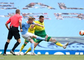 MANCHESTER, ENGLAND - JULY 26: Kevin De Bruyne of Manchester City scores his sides second goal during the Premier League match between Manchester City and Norwich City at Etihad Stadium on July 26, 2020 in Manchester, England.Football Stadiums around Europe remain empty due to the Coronavirus Pandemic as Government social distancing laws prohibit fans inside venues resulting in all fixtures being played behind closed doors. (Photo by Peter Powell/Pool via Getty Images)
