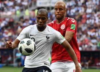 France's defender Djibril Sidibe (L) vies with Denmark's defender Mathias Jorgensen during the Russia 2018 World Cup Group C football match between Denmark and France at the Luzhniki Stadium in Moscow on June 26, 2018. / AFP PHOTO / Jewel SAMAD / RESTRICTED TO EDITORIAL USE - NO MOBILE PUSH ALERTS/DOWNLOADS