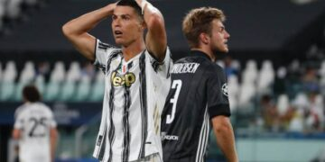 Juventus' Cristiano Ronaldo reacts during the Champions League round of 16 second leg, soccer match between Juventus and Lyon at the Allianz stadium in Turin, Italy, Friday, Aug. 7, 2020. (AP Photo/Antonio Calanni)