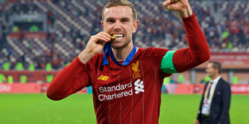 DOHA, QATAR - Saturday, December 21, 2019: Liverpool's captain Jordan Henderson bites his winners' medal after the FIFA Club World Cup Qatar 2019 Final match between CR Flamengo and Liverpool FC at the Khalifa Stadium. Liverpool won 1-0 after extra time. (Pic by David Rawcliffe/Propaganda)