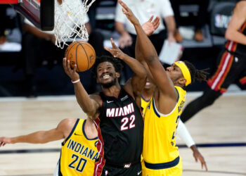 Aug 20, 2020; Lake Buena Vista, Florida, USA; Miami Heat's Jimmy Butler (22) shoots as Indiana Pacers' Myles Turner defends during the second half in an NBA basketball first round playoff game of the 2020 NBA playoffs at The Field House. Mandatory Credit: Ashley Landis/Pool Photo-USA TODAY Sports