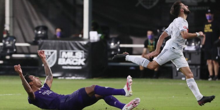 Orlando City's Antonio Carlos, left, celebrates after blocking a shot by LAFC's Diego Rossi, right, during the quarterfinals of the MLS is Back Tournament at Disney's ESPN Wide World of Sports complex in Orlando, Florida, on Friday, July 31, 2020. Orlando City advanced on penalty kicks after a 1-1 draw. (Stephen M. Dowell/Orlando Sentinel/Tribune News Service via Getty Images)