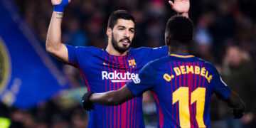 BARCELONA, SPAIN - FEBRUARY 24:  Luis Suarez of FC Barcelona celebrates with his teammate Ousmane Dembele after scoring his team's sixth goal during the La Liga match between Barcelona and Girona at Camp Nou on February 24, 2018 in Barcelona, Spain.  (Photo by Alex Caparros/Getty Images)