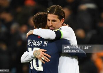 (FromL) Paris Saint-Germain's Brazilian forward Neymar and Real Madrid's Spanish defender Sergio Ramos great each other at the end of the UEFA Champions League group A football match Real Madrid against Paris Saint-Germain FC at the Santiago Bernabeu stadium in Madrid on November 26, 2019. (Photo by GABRIEL BOUYS / AFP) (Photo by GABRIEL BOUYS/AFP via Getty Images)