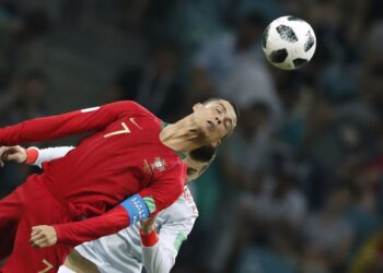 Portugal's forward Cristiano Ronaldo heads the ball during the Russia 2018 World Cup Group B football match between Portugal and Spain at the Fisht Stadium in Sochi on June 15, 2018. / AFP PHOTO / Odd ANDERSEN / RESTRICTED TO EDITORIAL USE - NO MOBILE PUSH ALERTS/DOWNLOADS