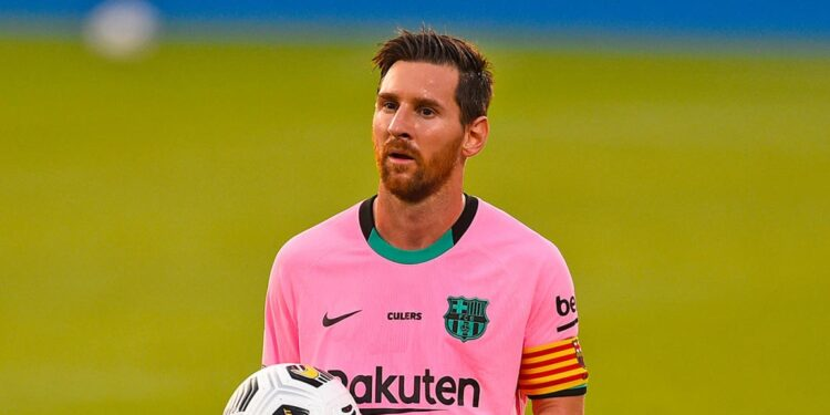Barcelona's Argentinian forward Lionel Messi grabs the ball during a friendly football match between FC Barcelona and Girona at the Johan Cruyff stadium in Sant Joan Despi near Barcelona on September 16, 2020. (Photo by Josep LAGO / AFP) (Photo by JOSEP LAGO/AFP via Getty Images)