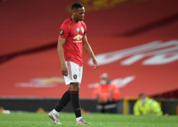 Manchester United's French striker Anthony Martial reacts on the pitch after the English Premier League football match between Manchester United and Southampton at Old Trafford in Manchester, north-west England, on July 13, 2020. - The game finished 2-2. (Photo by PETER POWELL / POOL / AFP) / RESTRICTED TO EDITORIAL USE. No use with unauthorized audio, video, data, fixture lists, club/league logos or 'live' services. Online in-match use limited to 120 images. An additional 40 images may be used in extra time. No video emulation. Social media in-match use limited to 120 images. An additional 40 images may be used in extra time. No use in betting publications, games or single club/league/player publications. /  (Photo by PETER POWELL/POOL/AFP via Getty Images)