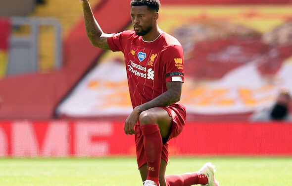 Liverpool's Dutch midfielder Georginio Wijnaldum takes a knee during the English Premier League football match between Liverpool and Burnley at Anfield in Liverpool, north west England on July 11, 2020. - Phil Noble (Photo by Oli SCARFF / POOL / AFP) / RESTRICTED TO EDITORIAL USE. No use with unauthorized audio, video, data, fixture lists, club/league logos or 'live' services. Online in-match use limited to 120 images. An additional 40 images may be used in extra time. No video emulation. Social media in-match use limited to 120 images. An additional 40 images may be used in extra time. No use in betting publications, games or single club/league/player publications. /  (Photo by OLI SCARFF/POOL/AFP via Getty Images)