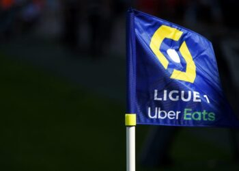 A flag of the French football division Ligue 1 with an Uber Eats logo is pictured prior to the French L1 football match between Nimes Olympique and Stade Brestois 29 on August 23, 2020, at the Costieres Stadium in Nimes, southern France. (Photo by Sylvain THOMAS / AFP) (Photo by SYLVAIN THOMAS/AFP via Getty Images)