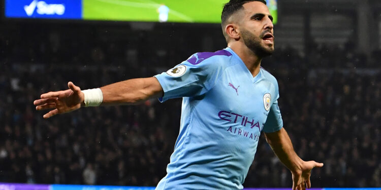 Manchester City's Algerian midfielder Riyad Mahrez celebrates after scoring their second goal during the English Premier League football match between Manchester City and Chelsea at the Etihad Stadium in Manchester, north west England, on November 23, 2019. (Photo by Paul ELLIS / AFP) / RESTRICTED TO EDITORIAL USE. No use with unauthorized audio, video, data, fixture lists, club/league logos or 'live' services. Online in-match use limited to 120 images. An additional 40 images may be used in extra time. No video emulation. Social media in-match use limited to 120 images. An additional 40 images may be used in extra time. No use in betting publications, games or single club/league/player publications. /  (Photo by PAUL ELLIS/AFP via Getty Images)