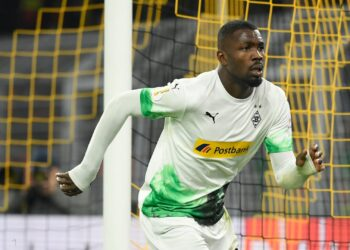 Moenchengladbach's French forward Marcus Thuram celebrates scoring the opening goal during the German Cup (DFB Pokal) second round football match BVB Borussia Dortmund v Borussia Moenchenglanbach in Dortmund, western Germany on October 30, 2019. (Photo by INA FASSBENDER / AFP) / DFB REGULATIONS PROHIBIT ANY USE OF PHOTOGRAPHS AS IMAGE SEQUENCES AND QUASI-VIDEO. (Photo by INA FASSBENDER/AFP via Getty Images)