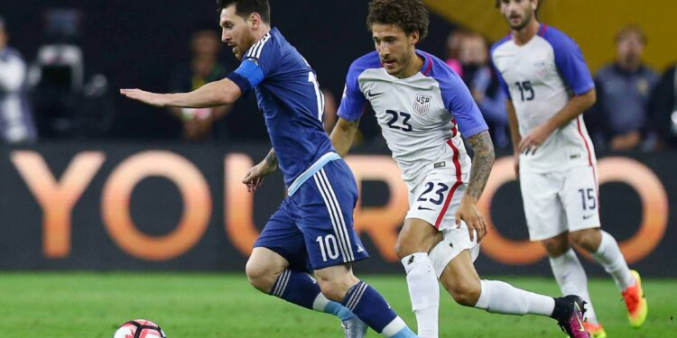 Argentina midfielder Lionel Messi (10) drives the ball downfield against United States defender Fabian Johnson (23) during the first half of a COPA America semi-final game at NRG Stadium, Tuesday, June 21, 2016, in Houston.  ( Jon Shapley / Houston Chronicle )
