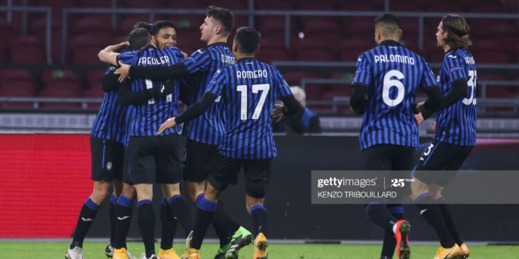 Atalanta's Colombian forward Luis Muriel (2nd-L) is congratulated by teammates after scoring a goal during the UEFA Champions League Group D football match between Ajax Amsterdam and Atalanta Bergamo, at the Johan Cruijff stadium in Amsterdam, on December 9, 2020. (Photo by Kenzo Tribouillard / AFP) (Photo by KENZO TRIBOUILLARD/AFP via Getty Images)