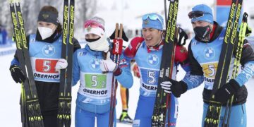Russia's team stand together after winning the mixed relay race at the Biathlon World Cup in Oberhof, Germany, Sunday, Jan. 10, 2021. (AP Photo/Matthias Schrader)