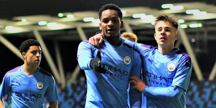 MANCHESTER, ENGLAND - DECEMBER 19: Manchester City's Jayden Braaf  celebrates scoring to make it 2-0 in action during the FA Youth Cup match between Manchester City and Swansea City at Manchester City Football Academy on December 19, 2019 in Manchester, England. (Photo by Tom Flathers/Manchester City FC via Getty Images)