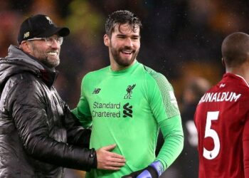 Liverpool manager Jurgen Klopp (left) goalkeeper Alisson Becker and Georginio Wijnaldum celebrate after the final whistle