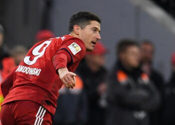 Soccer Football - Bundesliga - Bayern Munich v VfB Stuttgart - Allianz Arena, Munich, Germany - January 27, 2019  Bayern Munich's Robert Lewandowski celebrates scoring their fourth goal    REUTERS/Andreas Gebert  DFL regulations prohibit any use of photographs as image sequences and/or quasi-video