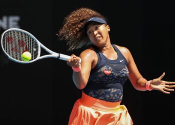 Japan's Naomi Osaka hits a return against Taiwan's Hsieh Su-wei during their women's singles quarter-final match on day nine of the Australian Open tennis tournament in Melbourne on February 16, 2021. (Photo by David Gray / AFP) / -- IMAGE RESTRICTED TO EDITORIAL USE - STRICTLY NO COMMERCIAL USE --