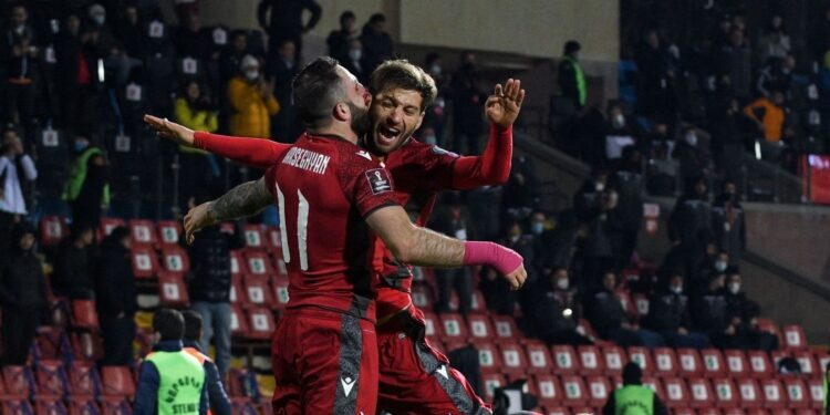Armenia's midfielder Tigran Barseghyan celebrates with teammates after scoring a goal during the FIFA World Cup Qatar 2022 qualification football match Armenia v Iceland in Yerevan on March 28, 2021. (Photo by Karen MINASYAN / AFP) (Photo by KAREN MINASYAN/AFP via Getty Images)