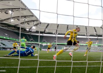 24 April 2021, Lower Saxony, Wolfsburg: Football: Bundesliga, VfL Wolfsburg - Borussia Dortmund, Matchday 31 at Volkswagen Arena. Dortmund's Erling Haaland (2nd from right) celebrates next to Marco Reus (right) after scoring the 0:1 goal. Photo: Swen Pförtner/dpa - IMPORTANT NOTE: In accordance with the regulations of the DFL Deutsche Fußball Liga and/or the DFB Deutscher Fußball-Bund, it is prohibited to use or have used photographs taken in the stadium and/or of the match in the form of sequence pictures and/or video-like photo series. (Photo by Swen Pförtner/picture alliance via Getty Images)