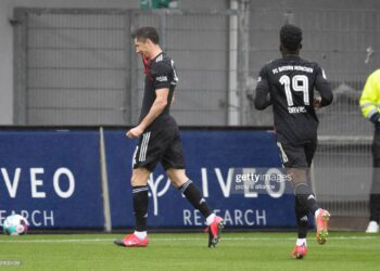 15 May 2021, Baden-Wuerttemberg, Freiburg im Breisgau: Football: Bundesliga, SC Freiburg - Bayern Munich, 33rd matchday at Schwarzwald-Stadion. Munich's Robert Lewandowski (l) celebrates after his goal to make it 0:1. Robert Lewandowski of FC Bayern München has equalled Gerd Müller's Bundesliga record of 40 goals in a season. Lewandowski scored his 40th goal of the season from the penalty spot in the 26th minute at SC Freiburg, equalling the record set in the 1971/72 season. Photo: Tom Weller/dpa - IMPORTANT NOTE: In accordance with the regulations of the DFL Deutsche Fußball Liga and/or the DFB Deutscher Fußball-Bund, it is prohibited to use or have used photographs taken in the stadium and/or of the match in the form of sequence pictures and/or video-like photo series. (Photo by Tom Weller/picture alliance via Getty Images)