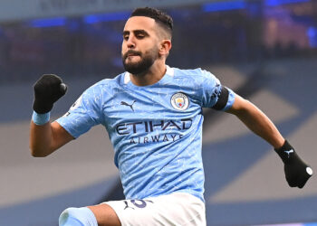 MANCHESTER, ENGLAND - NOVEMBER 28: Riyad Mahrez of Manchester City celebrates after scoring his team's first goal during the Premier League match between Manchester City and Burnley at Etihad Stadium on November 28, 2020 in Manchester, England. Sporting stadiums around the UK remain under strict restrictions due to the Coronavirus Pandemic as Government social distancing laws prohibit fans inside venues resulting in games being played behind closed doors. (Photo by Laurence Griffiths/Getty Images)