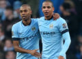 Manchester City's Fernandinho (left) celebrates scoring his side's second goal of the game with Fernando