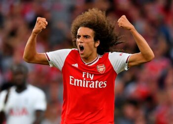 Arsenal's French midfielder Matteo Guendouzi celebrates after Arsenal's Gabonese striker Pierre-Emerick Aubameyang latched onto Guendouzi's pass to score their second goal to equalise 2-2 during the English Premier League football match between Arsenal and Tottenham Hotspur at the Emirates Stadium in London on September 1, 2019. (Photo by Ben STANSALL / AFP) / RESTRICTED TO EDITORIAL USE. No use with unauthorized audio, video, data, fixture lists, club/league logos or 'live' services. Online in-match use limited to 120 images. An additional 40 images may be used in extra time. No video emulation. Social media in-match use limited to 120 images. An additional 40 images may be used in extra time. No use in betting publications, games or single club/league/player publications. /         (Photo credit should read BEN STANSALL/AFP/Getty Images)