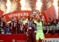 Leicester City's Wes Morgan (left) and Leicester City goalkeeper Kasper Schmeichel lift the trophy after the Emirates FA Cup Final at Wembley Stadium, London. Picture date: Saturday May 15, 2021. (Photo by Nick Potts/PA Images via Getty Images)