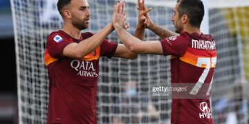 ROME, ITALY - MAY 09: Borja Mayoral of AS Roma celebrates with teammate Henrikh Mkhitaryan after scoring goal 1-0 during the Serie A match between AS Roma  and FC Crotone at Stadio Olimpico on May 09, 2021 in Rome, Italy. Sporting stadiums around Italy remain under strict restrictions due to the Coronavirus Pandemic as Government social distancing laws prohibit fans inside venues resulting in games being played behind closed doors. (Photo by Silvia Lore/Getty Images)