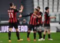 TURIN, ITALY - MAY 09: Brahim Diaz of A.C. Milan celebrates with Zlatan Ibrahimovic and Hakan Calhanoglu after scoring their side's first goal during the Serie A match between Juventus  and AC Milan at  on May 09, 2021 in Turin, Italy. Sporting stadiums around Italy remain under strict restrictions due to the Coronavirus Pandemic as Government social distancing laws prohibit fans inside venues resulting in games being played behind closed doors. (Photo by Valerio Pennicino/Getty Images)