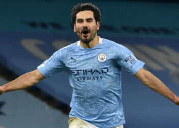 Manchester City's German midfielder Ilkay Gundogan celebrates scoring his team's third goal during the English Premier League football match between Manchester City and Tottenham Hotspur at the Etihad Stadium in Manchester, north west England, on February 13, 2021. (Photo by Rui Vieira / POOL / AFP) / RESTRICTED TO EDITORIAL USE. No use with unauthorized audio, video, data, fixture lists, club/league logos or 'live' services. Online in-match use limited to 120 images. An additional 40 images may be used in extra time. No video emulation. Social media in-match use limited to 120 images. An additional 40 images may be used in extra time. No use in betting publications, games or single club/league/player publications. /  (Photo by RUI VIEIRA/POOL/AFP via Getty Images)