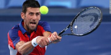 TOKYO, JAPAN - JULY 30: Novak Djokovic of Team Serbia plays a backhand during his Men's Singles Semifinal match against Alexander Zverev of Team Germany on day seven of the Tokyo 2020 Olympic Games at Ariake Tennis Park on July 30, 2021 in Tokyo, Japan. (Photo by Clive Brunskill/Getty Images)