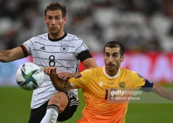 Germany's midfielder Leon Goretzka (L) and Armenia's midfielder Henrikh Mkhitaryan vie for the ball during the FIFA World Cup Qatar 2022 qualification Group J football match between Germany and Armenia, in Stuttgart, on September 5, 2021. (Photo by CHRISTOF STACHE / AFP) (Photo by CHRISTOF STACHE/AFP via Getty Images)