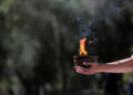 Winter Olympics - Lighting ceremony of the Olympic flame for the Beijing 2022 Winter Olympics - Ancient Olympia, Olympia, Greece - October 18, 2021 A cauldron and flame is held by a performer during the Olympic flame lighting ceremony for the Beijing 2022 Winter Olympics REUTERS/Costas Baltas